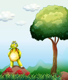 A turtle standing above the rock near the tree. Illustration of a turtle standing above the rock near the tree Stock Images