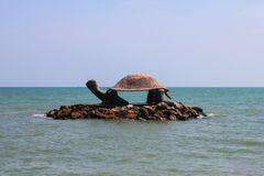 The turtle statuary. In the middle of the sea Stock Photos