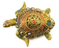Turtle statuette with gemstones isolated on the white background Royalty Free Stock Photography
