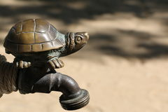 Turtle on the Tap. The Turtle Iron on the Tap Royalty Free Stock Photography