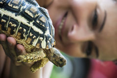 Turtle and woman Stock Image
