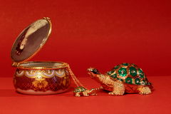 Turtles and boxes. Ornaments made of nacre, which is extracted from the sea or river shells. It is very similar to pearl jewelry, which is also formed in the Royalty Free Stock Photo