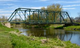 Turtleville Iron Bridge. This is a Spring picture of the Turtleville Iron Bridge across Turtle Creek near Beloit, Wisconsin. The bridge built in 1887 is an royalty free stock image