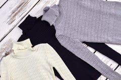 Turtlreneck ha tricottato la regolazione dei maglioni Fotografia Stock