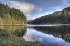 Turton & Entwistle Reservoir. A timed exposure showing the utter stillness of the Turton & Entwistle Reservoir in Lancashire, UK stock image