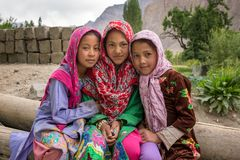 Unidentified Balti girls poses for a photo in Turtuk village on the border with Pakistan, Ladakh, India. Turtuk, India - June 28, 2017: Unidentified Balti girls stock image