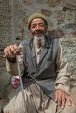 Unidentified senior Balti man poses for a photo in Turtuk village on the border with Pakistan, Ladakh, India. Turtuk, India - June 28, 2017: Unidentified senior royalty free stock photography