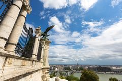 Turul Eagle Statue on Castle hill with view of Szechenyi Chain suspension bridge, Budapest, Hungary. Turul Eagle Statue on Castle hill with view of Szechenyi royalty free stock photo