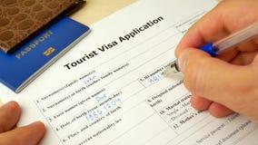 Turystyczna wniosek wizowy forma z paszportem i piórem zbiory