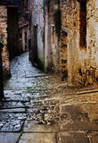 Tuscan alley at night. Grunge dark alley with staircase at night in the old tuscan village Royalty Free Stock Photos