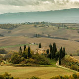 Tuscan autumn landscape. Lonely farmhouse with golden meadow hills. Tuscan autumn landscape. Tuscan Villa on countryside, San Quirico d´Orcia, Tuscany, Italy Stock Photos