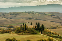Tuscan autumn landscape. Lonely farmhouse with golden meadow hills. Tuscan autumn landscape. Tuscan Villa on countryside, San Quirico d´Orcia, Tuscany, Italy Stock Images