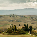 Tuscan autumn landscape. Lonely farmhouse with golden meadow hills. Tuscan autumn landscape. Tuscan Villa on countryside, San Quirico d´Orcia, Tuscany, Italy Stock Photography