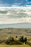 Tuscan autumn landscape. Lonely farmhouse with golden meadow hills. Tuscan autumn landscape. Tuscan Villa on countryside, San Quirico d´Orcia, Tuscany, Italy Royalty Free Stock Photo