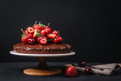 Tuscan chocolate cake with strawberries and cherries Royalty Free Stock Images