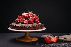 Tuscan chocolate cake with strawberries and cherries Stock Photos