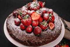Tuscan chocolate cake with strawberries and cherries Stock Photography