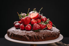 Tuscan chocolate cake with strawberries and cherries Stock Photo