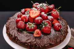 Tuscan chocolate cake with strawberries and cherries Royalty Free Stock Photography