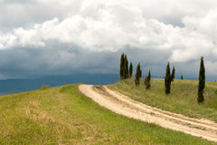 Tuscan clouds and cypress trees Stock Photo