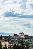 Tuscan country, rural scene, clouds, houses and greenery Stock Image