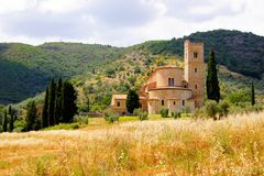 Tuscan countryside with abbey. Abbey of Sant'Antimo among the hills of Tuscany, Italy Royalty Free Stock Photography