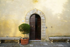 Tuscan entrance. The main door of an elegant tuscan villa Stock Photo