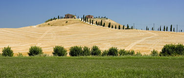 Tuscan Farm in Siena. Typical farm in an area called Crete Senesi near Siena, Tuscany Royalty Free Stock Photos