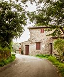 Tuscan farmhouse, Chianti, Italy. Stone Tuscan farmhouse on tree lined road in Chianti, Italy on sunny day royalty free stock photo