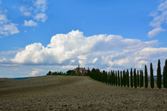 Tuscan Farmhouse. With cypress road stock photography