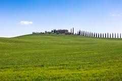 Tuscan farmhouse and cypress trees Stock Photos