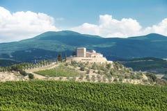 Tuscan Farmhouse on hill landscape Stock Image