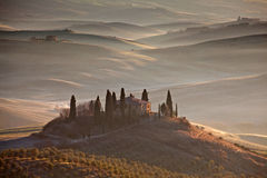 Tuscan farmhouse in morning mist Royalty Free Stock Photos