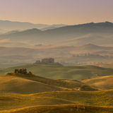 Tuscan Farmland with Villas and Villages at Dawn Royalty Free Stock Images