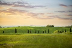 Tuscan hill with row of cypress trees and farmhouse ruin at sunset. Tuscan landscape. Tuscany, Italy. The Tuscan landscape, depicted in countless works, has been royalty free stock images