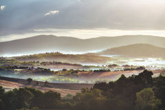 Tuscan hills in the fog Royalty Free Stock Photos