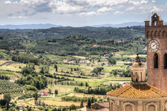 Tuscan landscape with cathedral in San Miniato, Italy. View over the impressive landscape in Tuscany with the cathedral of San Miniato in Italy royalty free stock photography