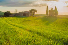 Tuscan landscape with a chapel at sunset Royalty Free Stock Photography