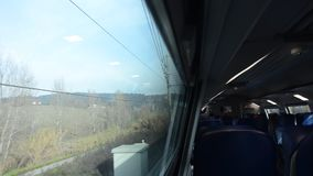 Tuscan landscape from the commuter train. Tuscan landscape from inside the commuter train stock video footage