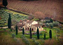 Tuscan landscape with cypress, trees and ancient buildings. Tuscan landscape and country road with cypress, trees and ancient buildings. Tuscany region in Italy Royalty Free Stock Photography