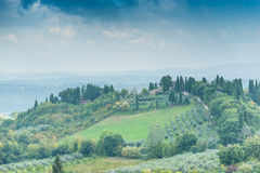 Tuscan landscape early autumn with houses and dramatic sky Stock Image