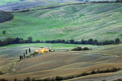 Tuscan landscape with farmhouse. Italy, Tuscan landscape with farmhouse royalty free stock photography