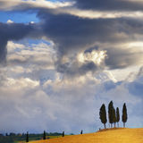 Tuscan landscape. Idyllic rural Tuscan landscape near Pienza under thunderstorm sky, Vall d'Orcia Italy, Europe Royalty Free Stock Image