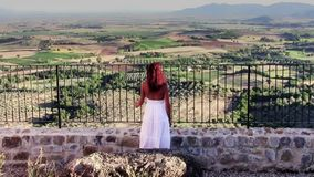 Tuscan landscape and red-haired lady in white. Italy, Tuscany. typical landscape and beautiful woman stock footage