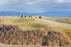 Tuscan landscape in winter, Val d'Orcia (Italy). In the background the little church Cappella della Madonna di Vitaleta stock photography