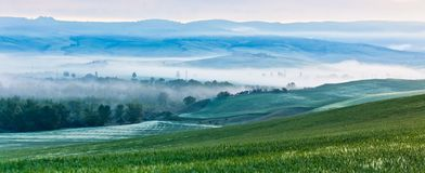 Tuscan morning fog view Stock Image