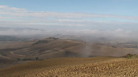 Tuscan morning pan. Dew coming in as the sun rises over the Tuscan Val d'Orcia stock footage