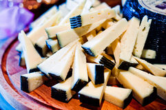 Tuscan pecorino cheese from the black crust, typical Italian che. Semi-hard cheese from the black crust served in wedges portion Stock Images
