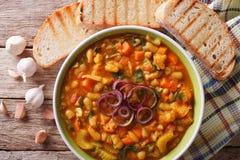 Tuscan ribollita soup close up in a bowl. horizontal top view Stock Photos