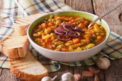 Tuscan ribollita thick soup with bread close up on the table. ho Royalty Free Stock Image